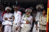 Wedding guests take shelter from monsoon rains...by Michael Benanav - mbenanav@gmail.com
