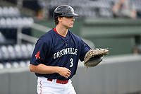 Catcher Charlie Madden (3) of the Greenville Drive warms up before a game against the Augusta GreenJackets on Wednesday, April 25, 2018, at Fluor Field at the West End in Greenville, South Carolina. Augusta won, 9-2. (Tom Priddy/Four Seam Images)