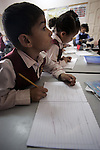 Palestinian students Deafs attend  lesson at The School el-Amal Rehabilitation of Deafs, at Rafah town in the southern Gaza Strip on October 21, 2009. The school for Deaf that was established in 1991 with the sponsorship of by the Agency France for Development, teach some 160 students Deafs in the school, faces the threat of closure because of the longstanding Israeli blockade on the Gaza Strip. Photo by Abed Rahim Khatib