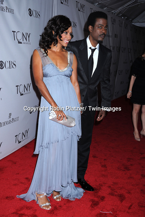Malaak Rock and Chris Rock attending the 65th Annual Tony Awards at the Beacon Theatre in New York City on June 12, 2011.