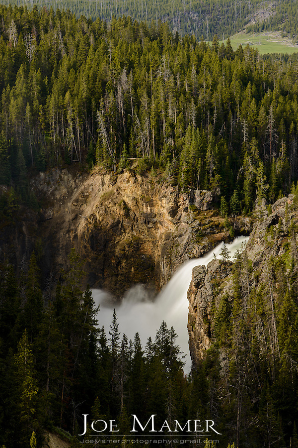 Upper Yellowstone Falls of the Yellowstone River in Yellowstone National Park as viewed from the North Rim during heavy spring flow.