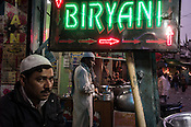 Customers and vendors seen in biryani stalls in Nizamuddin, New Delhi, India.