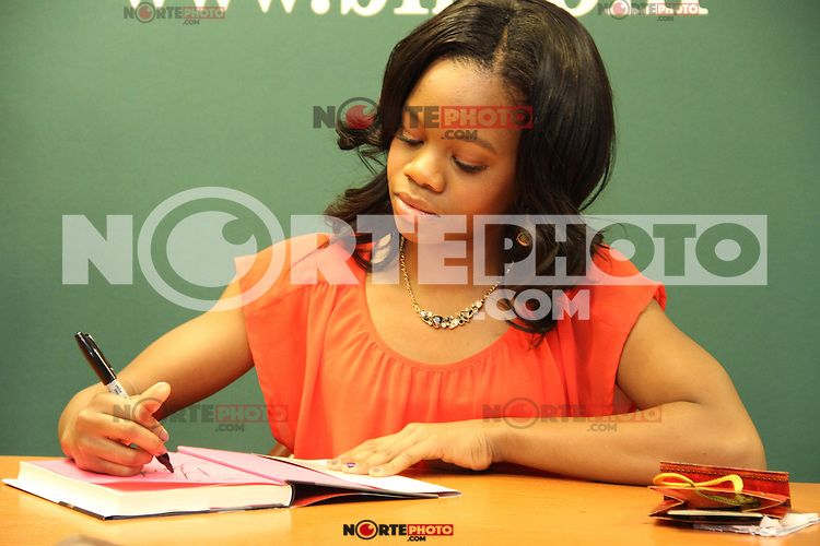 "NEW YORK, NY - DECEMBER 4: Gabby Douglas signs copies of her ""Grace , Gold & Glory"" book at Barnes & Noble on December 4, 2012 in New York City. Credit: Walik Goshorn / Retna Ltd./MediaPunch Inc. ©/NortePhoto /NortePhoto© /NortePhoto /NortePhoto"