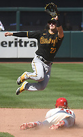 25th July 2020, St Louis, MO, USA;  Pittsburgh Pirates infielder Kevin Newman (27) leaps for the throw as St. Louis Cardinals center fielder Harrison Bader steals second during a Major League Baseball game between the Pittsburgh Pirates and the St. Louis Cardinals