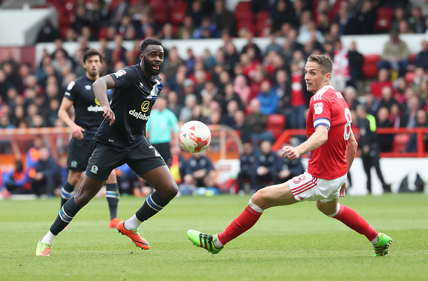 Blackburn Rovers' Hope Akpan and Nottingham Forest's Chris Cohen<br /> <br /> Photographer Rachel Holborn/CameraSport<br /> <br /> The EFL Sky Bet Championship - Nottingham Forest v Blackburn Rovers - Friday 14th April 2016 - The City Ground - Nottingham<br /> <br /> World Copyright &copy; 2017 CameraSport. All rights reserved. 43 Linden Ave. Countesthorpe. Leicester. England. LE8 5PG - Tel: +44 (0) 116 277 4147 - admin@camerasport.com - www.camerasport.com