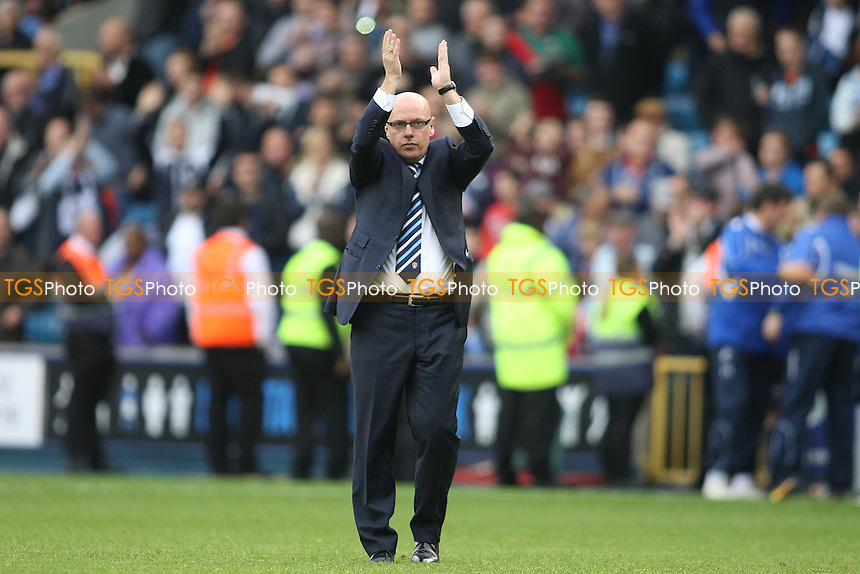 Brian McDermott manager of Leeds United applauds the fans at the final whistle- Millwall vs Leeds United - Sky Bet Championship Football at the New Den, South Bermondsey, London - 28/09/13 - MANDATORY CREDIT: George Phillipou/TGSPHOTO - Self billing applies where appropriate - 0845 094 6026 - contact@tgsphoto.co.uk - NO UNPAID USE