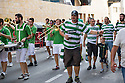 Celtic fans arrive at Estadio El Madrigal accompanied by a local brass band.