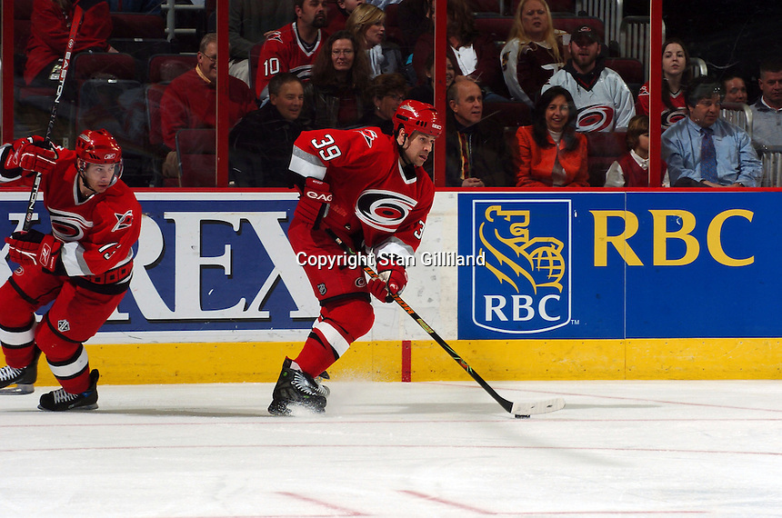 Carolina Hurricanes' Doug Weight turns the puck up the ice followed by teammate Ray Whitney, left, during a game with the Florida Panthers Friday, March 3, 2006 at the RBC Center in Raleigh, NC. Carolina won 5-2.