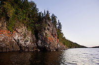 The rugged exposed cliffs on the shoreline along Blake Point at Isle Royale National Park.