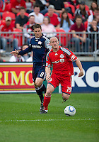 22 May 2010: Toronto FC forward Chad Barrett #19 and New England Revolution midfielder Chris Tierney #8 in action during a game between the New England Revolution and Toronto FC at BMO Field in Toronto..Toronto FC won 1-0.....