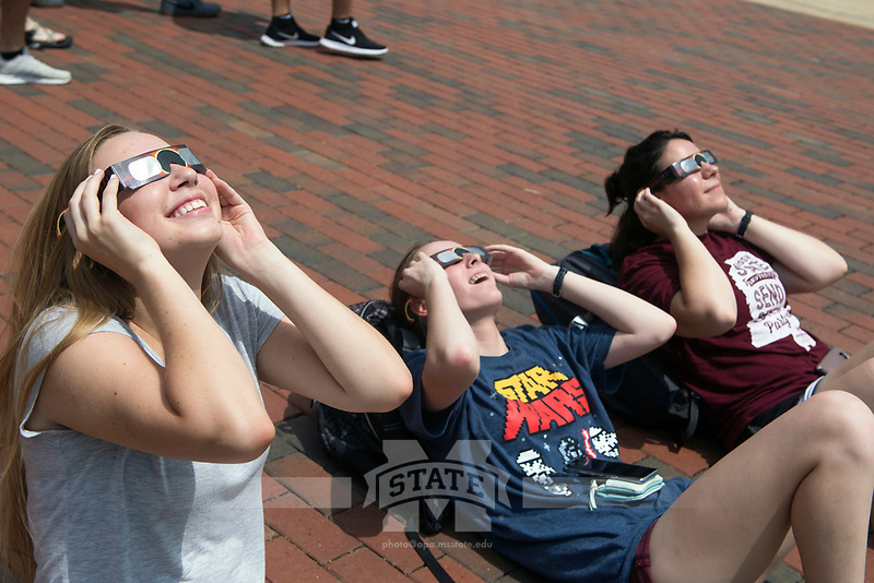 Students viewing the solar eclipse on the Drill Field<br />  (photo by Beth Wynn / &copy; Mississippi State University)