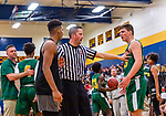 WATERBURY, CT. 09 December 2018-120918 - Official Tim Lynch, center gets in between WCA center Marquan Watson #22, left and Holy Cross' Jack Greene #33 as they exchange words during the annual Waterbury Boys Basketball Jamboree at Kennedy High School in Waterbury on Sunday. Bill Shettle Republican-American