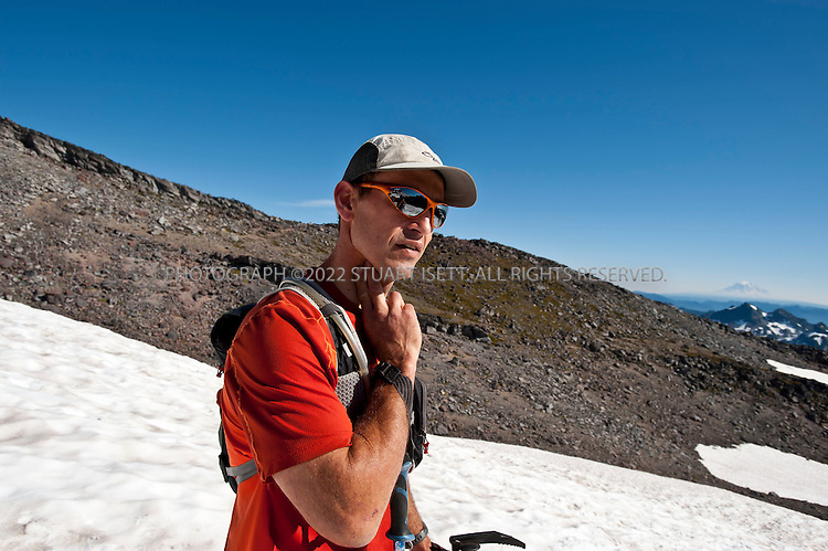 9/14/2011--Mt. Rainier, WA, USA..Cha Kellogg checks his pulse...Climber Chad Kellogg, 39, training on Mt. Rainier, WASH., for the world speed record climb on Mt. Everest that he will attempt in May, 2012. Kellogg climbs solo and without oxygen...A former competitive luger, Kellogg is a Buddhist who wakes everyday at 4 a.m. to meditate before heading out for training and work. A few years ago, Kellogg had part of his colon removed because of cancer and also lost his first wife to a climbing accident..©2011 Stuart Isett. All rights reserved.