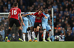 Ander Herrera of Manchester United is tackled by Fernandinho and Yaya Toure of Manchester City during the English Premier League match at The Etihad Stadium, Manchester. Picture date: April 27th, 2016. Photo credit should read: Lynne Cameron/Sportimage