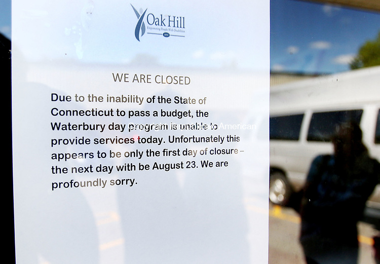WATERBURY CT. 26 July 2017-072617SV05-A note on the door lets clients know the Oak Hill Day Program on East Main Street was closed in Waterbury Wednesday. The day program was closed for a state furlough day due to the state not having a budget. <br /> Steven Valenti Republican-American