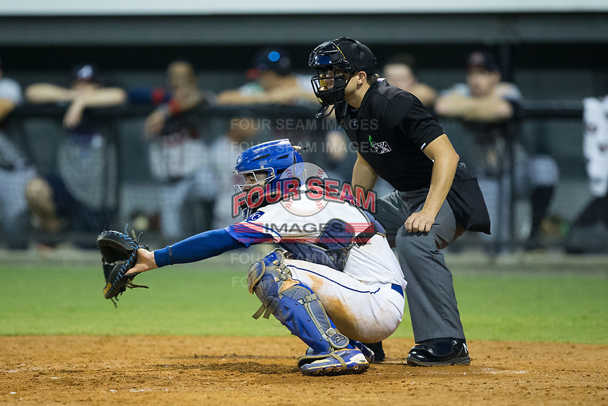 Burlington Royals catcher Sebastian Rivero (3) sets a target as home plate umpire Steven Hodgins looks on during the game against the Danville Braves at Burlington Athletic Stadium on August 14, 2017 in Burlington, North Carolina.  The Royals defeated the Braves 9-8 in 10 innings.  (Brian Westerholt/Four Seam Images)