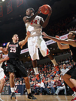 Dec. 22, 2010; Charlottesville, VA, USA; Virginia Cavaliers guard K.T. Harrell (24) grabs a rebound in front of Seattle Redhawks forward Brandon Durham (25) during the game at the John Paul Jones Arena. Seattle Redhawks won 59-53. Mandatory Credit: Andrew Shurtleff