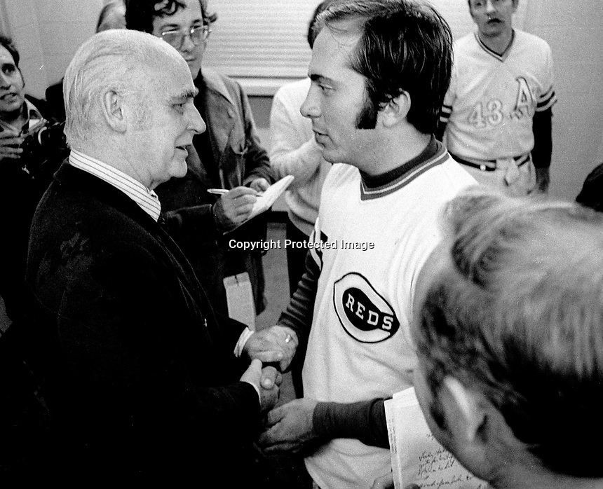Cincinnati Reds catcher Johnny Bench congratulates Oakland Athletics owner Charlie Finley in the dressing room after the A's defeated the Reds in the 1972 World Series. (photo/Ron Riesterer)