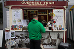 A home fan at a refreshment kiosk as Guernsey take on Corinthian-Casuals in a Isthmian League Division One South match at Footes Lane. Formed in 2011, Guernsey FC are a community club located in St. Peter Port on the island of Guernsey and were promoted to the Isthmian League Division One South in 2013. The visitors from Kingston upon Thames won the fixture by 1-0, watched by a crowd of 614 spectators.