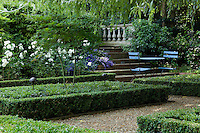 Steps lead up from the sunken garden to a terrace above