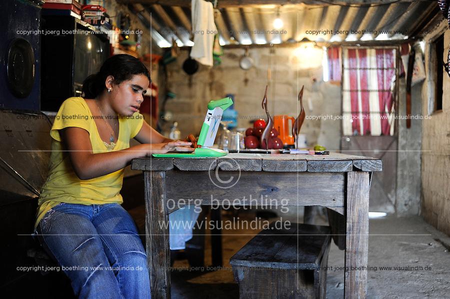 URUGUAY Montevideo, OLPC One Laptop per Child project, the 100 Dollar laptop initiative of Nicholas Negroponte, is implemented in Uruguay for children at all schools under Plan Ceibal, laptops also have access to the internet, girl Mimosa Almeida in suburb La Bolyada / URUGUAY Montevideo, fuer alle Kinder an  staatlichen Schulen Uruguays ist das OLPC one laptop per child Programm als Bildungsinitiative Plan Ceibal umgesetzt , jedes Kind bekommt einen 100 Dollar Laptop XO-1 und Zugang zum W-lan Netz der Schule