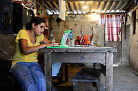URUGUAY Montevideo, OLPC One Laptop per Child project, the 100 Dollar laptop initiative of Nicholas Negroponte, is implemented in Uruguay for children at all schools under Plan Ceibal, laptops also have access to the internet, girl Mimosa Almeida in suburb La Bolyada / URUGUAY Montevideo, fuer alle Kinder an  staatlichen Schulen Uruguays ist das OLPC one laptop per child Programm als Bildungsinitiative Plan Ceibal umgesetzt , jedes Kind bekommt einen 100 Dollar Laptop XO-1 und Zugang zum W-lan Netz der Schule