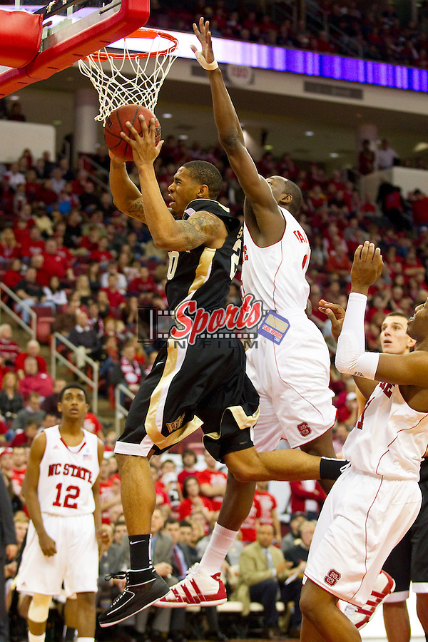 Ari Stewart #20 of the Wake Forest Demon Deacons drives to the basket past DeShawn Painter #0 of the North Carolina State Wolfpack at the RBC Center on January 8, 2011 in Raleigh, North Carolina.  The Wolfpack defeated the Demon Deacons 90-69.  Photo by Brian Westerholt / Sports On Film