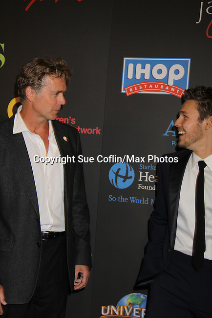John Schneider and Scott Clifton at the 38th Annual Daytime Entertainment Emmy Awards 2011 held on June 19, 2011 at the Las Vegas Hilton, Las Vegas, Nevada. (Photo by Sue Coflin/Max Photos)