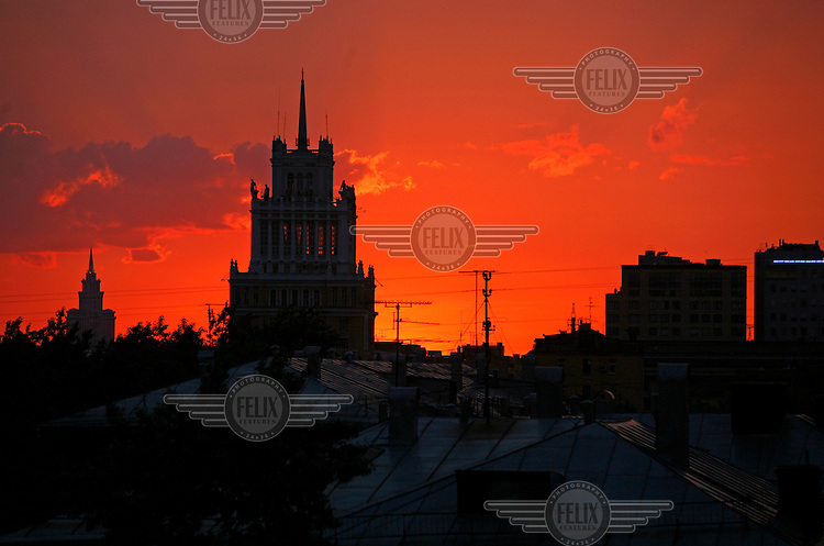 The skyline of central Moscow with a red sky.