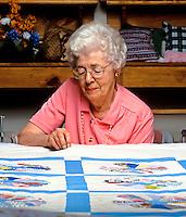 Senier woman quiltting