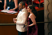 Jordan Peele, left, and Chelsea Peretti appear in the audience at the Oscars on Sunday, March 4, 2018, at the Dolby Theatre in Los Angeles. (Photo by Chris Pizzello/Invision/AP)