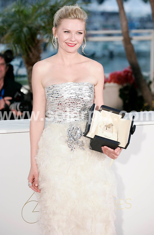 **ALL ROUND PICTURES FROM SOLARPIX.COM**                                             **UK AND SPAIN SYNDICATION RIGHTS ONLY**                                                                                  Caption: Golden Globe awards winner´s photocall at the  64th Cannes Film Festival in France.                                                                              This pic: Kirsten Dunst                                                                                             JOB REF:13418        CPR/Heinz       DATE:23.05.2011                                                          **MUST CREDIT SOLARPIX.COM OR DOUBLE FEE WILL BE CHARGED**                                                                      **MUST AGREE FEE BEFORE ONLINE USAGE**                               **CALL US ON: +34 952 811 768 or LOW RATE FROM UK 0844 617 7637**