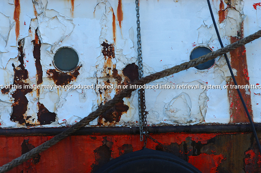 Port Holes on the side of a rusting ship