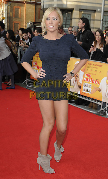 AISLEYNE HORGAN WALLACE.The World Premiere of 'The Infidel' at the Hammersmith Apollo, London, England, UK..April 8th, 2010.arrivals full length black dress ruched body con hands on hips shoulder pads eighties grey gray peep toe beige ankle boots blue.CAP/CAN.©Can Nguyen/Capital Pictures.
