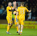 MOTHERWELL'S MICHAEL HIGDON APPLAUDS THE FANS AT THE END OF THE GAME