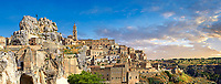 Panoramic view of the ancient Sassi of Matera area exterior, Basilicata, Italy. <br /> <br /> The area of Matera has been occupied since the Palaeolithic (10th millennium BC) making it one of the oldest continually inhabited settlements in the world. <br /> <br /> The town of Matera was founded by the Roman Lucius Caecilius Metellus in 251 BC and remained a Roman town until  was conquered by the Lombards In AD 664 becoming part of the Duchy of Benevento.  Matera was subject to the power struggles of southern Italy coming under the rule of the Byzantine Roman, the Germans and finally Matera was ruled by the Normans from 1043 until the Aragonese took possession in the 15th century. <br /> <br /> At the ancient heart of Matera are cave dwellings known as Sassi. As the fortunes of Matera failed the sassy became slum dwelling and the appalling living conditions became be the disgrace of Italy. From the 1970's families were forcibly removed from the Sassi and rehoused in the new town of Matera. Today tourism has regenerated Matera and the sassi have been modernised and are lived in again making them probably the longest inhabited houses in the world dating back 9000 years.