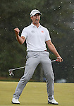 AUGUSTA, GA - APRIL 14: Adam Scott of Australia reacts  after sinking a birdie putt on the 18th green to force a playoff with Angel Cabrera of Argentina during the Final Round of the 2013 Masters Golf Tournament at Augusta National Golf Club on April 14, 2013 in Augusta, Georgia. Adam Scott became the first Australian ever to win the famed Masters Golf Tournament, one of the four major championships, in it's 79 year history.