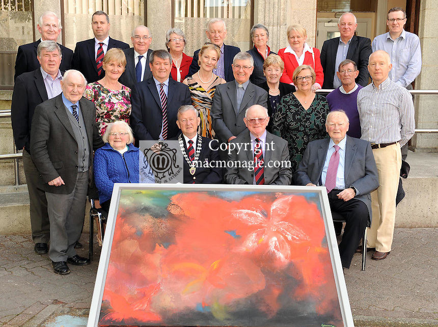 Pictured at Killarney Town Hall on Friday where the Killarney London  Reunion Committee presented a  painting by Gemma Billington  to Killarney Town Council in recognition of  the support given to the reunion group over the past 45 years, were front from left,  Peggy Looney, Cllr Donal Grady, Dan Grimes and Paddy MacMonagle. Second row from left are Cllr Sean Counihan, Donie Sheahan, Noreen Looney, Noel O'Sullivan,  Gemma  Billington,   Fr Sean Hanafin, Bridie Grimes, Sheila Casey, Corry O'Flaherty and Johnny McGuire. Back from left are  Cllr Cathal Walshe,  Cllr Niall O'Callaghan, Senator Paul Coghlan, Breda  Sheehan, Cllr Sean O'Grady, Betty Twomey,  Annette Ecker, Town Clerk Michael O'Leary and Cllr Tom Doherty. Picture: Eamonn Keogh (MacMonagle, Killarney)