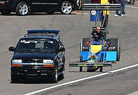 Feb. 23, 2013; Chandler, AZ, USA; NHRA top fuel dragster driver Sidnei Frigo during qualifying for the Arizona Nationals at Firebird International Raceway. Mandatory Credit: Mark J. Rebilas-