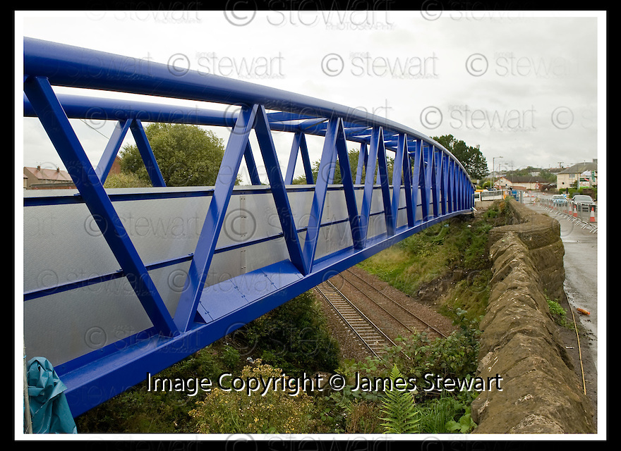 23/08/2009  Copyright  Pic : James Stewart.sct_jspa08_new_bridge  .THE LONGEST 'WARREN TRUSS' FOOTBRIDGE IN SCOTLAND, 56M (184FT) LONG AND 1.8M (6FT) WIDE,  IN PLACE OVER THE RAILWAY AT REDDING, NEAR FALKIRK......James Stewart Photography 19 Carronlea Drive, Falkirk. FK2 8DN      Vat Reg No. 607 6932 25.Telephone      : +44 (0)1324 570291 .Mobile              : +44 (0)7721 416997.E-mail  :  jim@jspa.co.uk.If you require further information then contact Jim Stewart on any of the numbers above.........