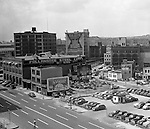 Pittsburgh PA:  View of the point area prior to the Gateway Center construction - 1949.  Eppy's parking lot at Liberty Avenue and Fancourt Street in Pittsburgh.  Follansbee Steel Corporation and Dravo Corporation offices in Pittsburgh. Company signs on the city buildings included: North Side Packing Company's Victory Sausage, Wonder-lite Manufacturing Company & Esser Costume Company