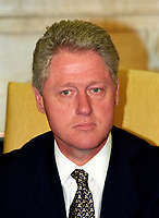 """United States President Bill Clinton meets with reporters in the Oval Office of the White House in Washington, DC to discuss the situation in Iraq following the two strikes by US cruise missiles against Iraqi military targets on September 4, 1996.  The President announced the attacks were successful and said that Iraqi leader Saddam Hussein """"knows there is a price to be paid for stepping over the line."""" Photo Credit: Ron Sachs/CNP/AdMedia"""
