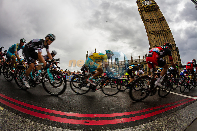 The peleton including Yellow Jersey leader Vincenzo Nibali (ITA) Astana pass the Houses of Parliment Westminster near the end of Stage 3 of the 2014 Tour de France running 155km from Cambridge to London. 7th July 2014.<br /> Picture:Thomas Van Bracht/Peleton Photos/www.newsfile.ie