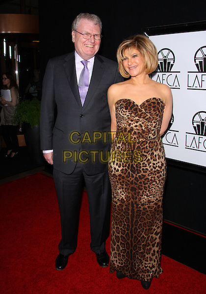 HOWARD STRINGER & AMY PASCAL .The 38th Annual Los Angeles Film Critics Association Awards  held at The InterContinental Hotel, Los Angeles, CA, USA, 15th January 2011..full length grey gray suit purple tie strapless brown leopard print long maxi dress .CAP/ADM/TC.©T. Conrad/AdMedia/Capital Pictures.