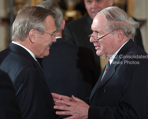 Washington, D.C. - April 4, 2005 -- United States Secretary of Defense Donald Rumsfeld shares an animated conversation with United States Senator Carl Levin (Democrat of Michigan) prior to the Medal of Honor ceremony in the East Room of the White House in Washington, D.C. on April 4, 2005.  Senator Levin is the Ranking Member of the United States Senate Armed Services Committee which maintains oversight of the United States Department of Defense.<br /> Credit: Ron Sachs / CNP