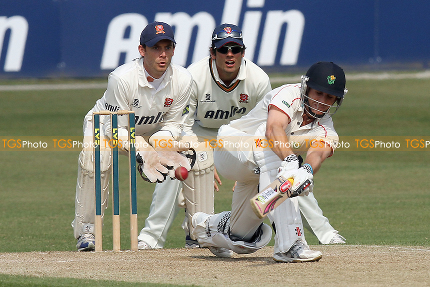 Mark Wallace of Glamorgan plays the sweep shot as Alastair Cook and James Foster look on - Essex CCC vs Glamorgan CCC - LV County Championship Division Two Cricket at the Ford County Ground, Chelmsford - 28/04/11 - MANDATORY CREDIT: Gavin Ellis/TGSPHOTO - Self billing applies where appropriate - Tel: 0845 094 6026