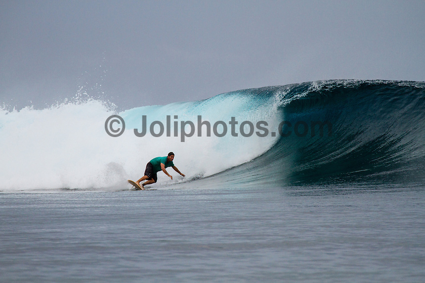 Namotu Island Resort, Fiji. (Thursday, August 30, 2012) -  There were very light winds this morning and a small increase in the swell  providing glassy conditions  at Cloudbreak, Namotu Lefts and Wilkes. After a spectacular sunrise the clouds moved in and light rain fell on and off all day.  Photo: joliphotos.com