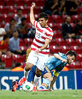 USA U20's Mikey Lopez (L) during their FIFA U-20 World Cup Turkey 2013 Group Stage Group A soccer match USA U20 betwen Spain at the Kadir Has stadium in Kayseri on June 21, 2013. Photo by Aykut Akici/isiphotos.com