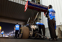Sept. 28, 2012; Madison, IL, USA: Crew members stand with the car of NHRA top fuel dragster driver T.J. Zizzo during qualifying for the Midwest Nationals at Gateway Motorsports Park. Mandatory Credit: Mark J. Rebilas-