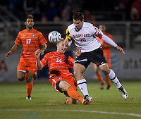 Kyle Fisher (26) of Clemson tackles the ball away from Jake Pace (20) of Maryland during the game at the Maryland SoccerPlex in Germantown, MD. Maryland defeated Clemson, 1-0, in overtime.  With the win the Terrapins advanced to the finals of the ACC men's soccer tournament.